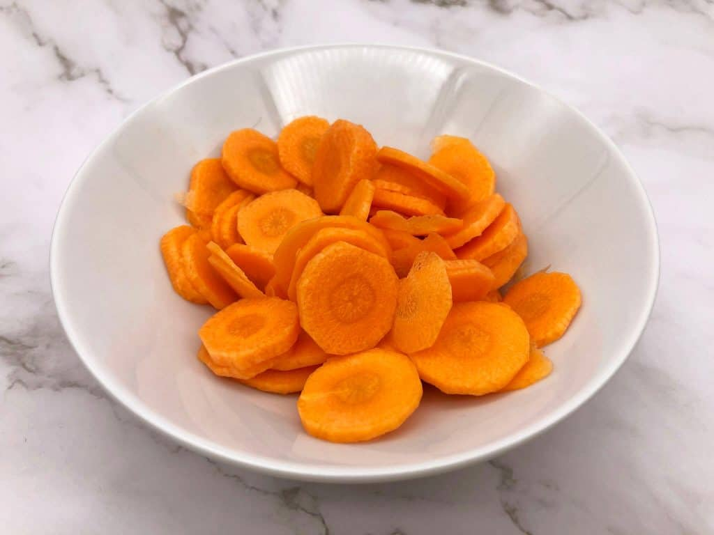 A bowl of sliced carrots