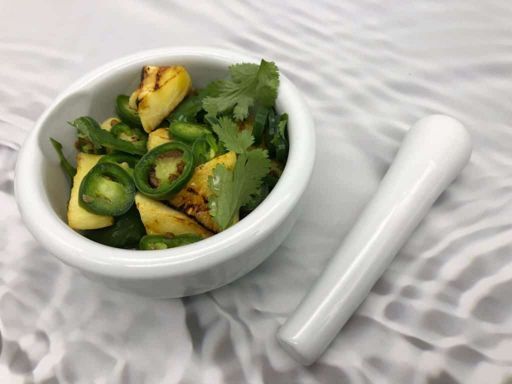 Chilli, coriander and pineapple in a mortar and pestle