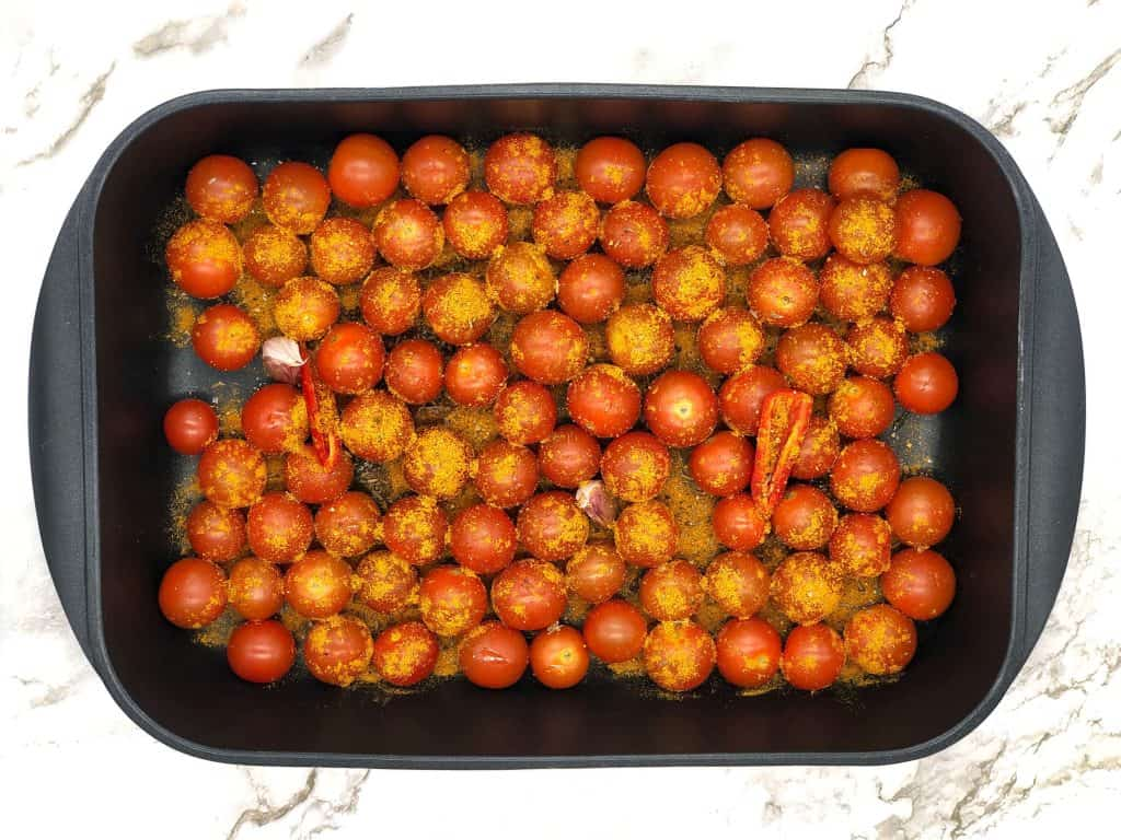 Cherry tomatoes, chilli, garlic and spices ready to roast