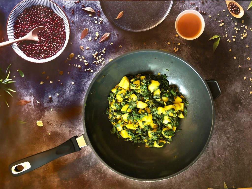 Saag aloo in a pan on a table