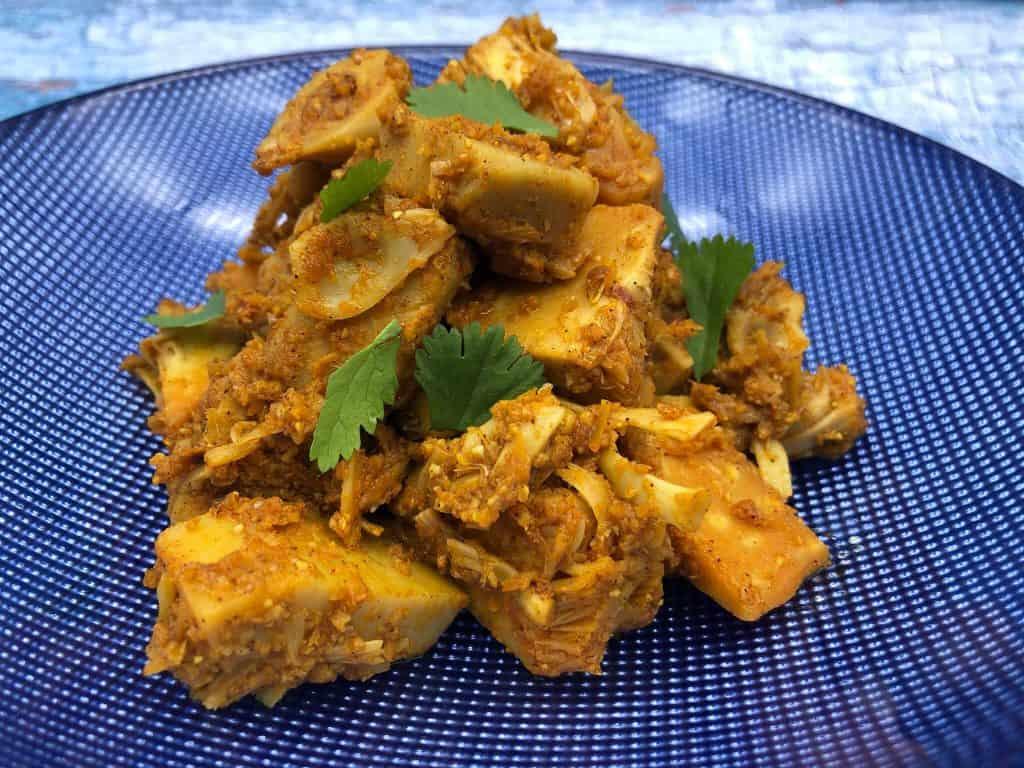 Tasty jackfruit curry on a blue plate