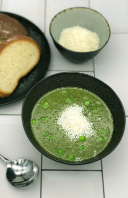 Easy peasy Pea and mint soup with parmesan, bread and a spoon