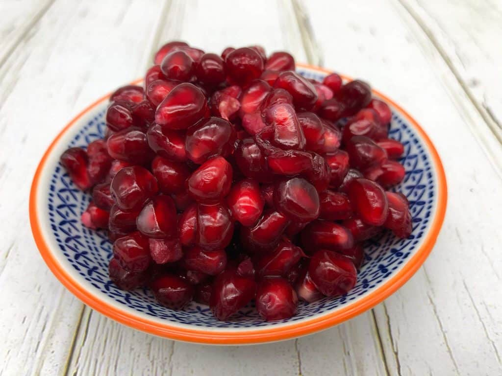 Pomegranate seeds in a dish
