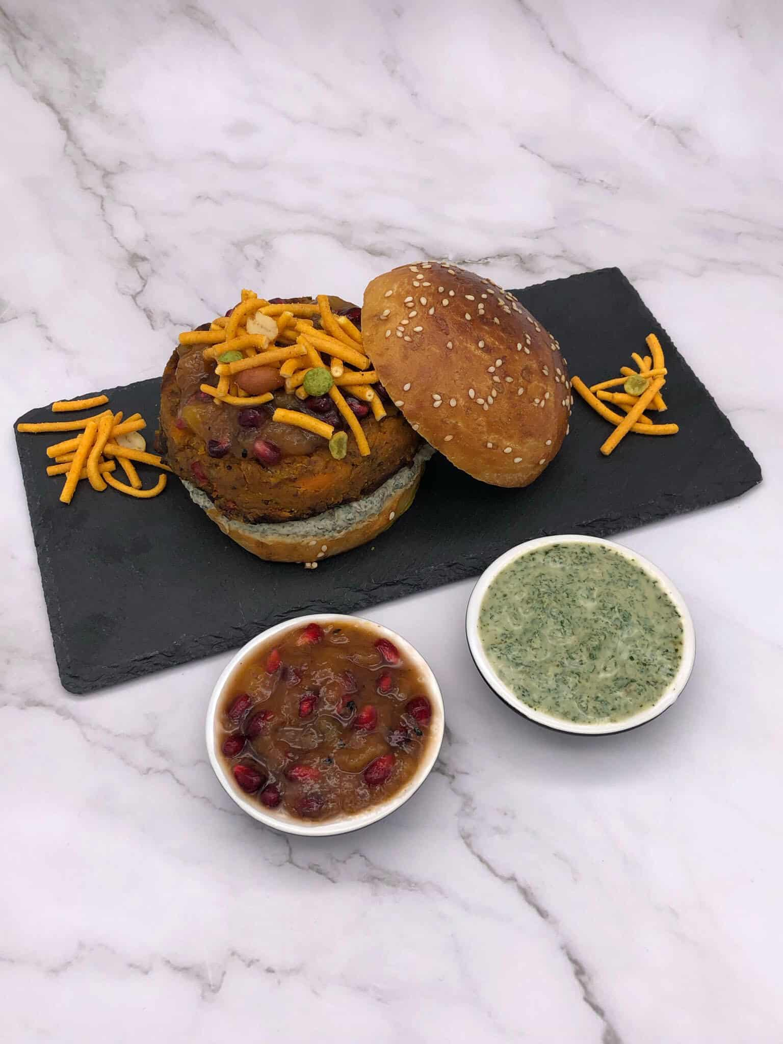 Tasty Veggie street burger on a slate and with sauces
