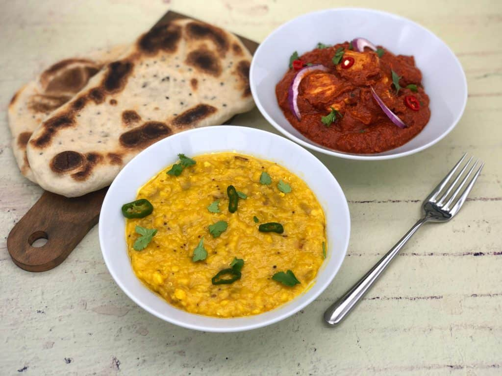 Tarka dhal with chicken madras and naan bread