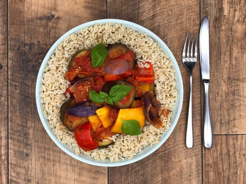 Tasty vegan ratatouille and a knife and fork
