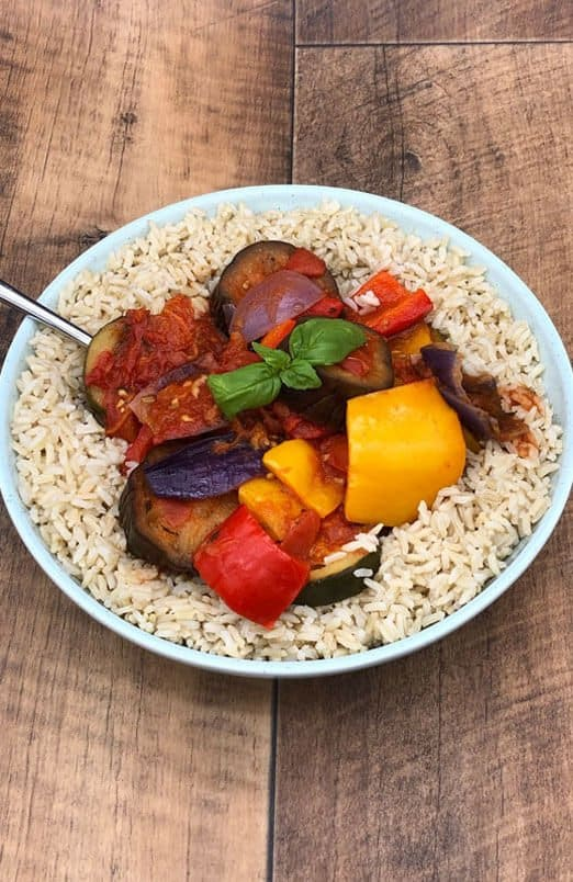 Vegan tasty ratatouille on a bed of brown rice