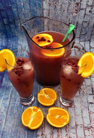 Orange, cranberry and pomegranate spritzer