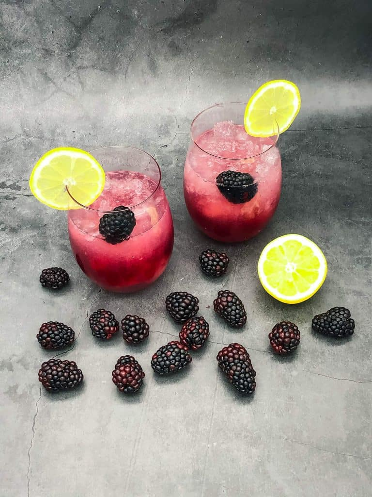 Delicious Bramble cocktails with blackberries and lemon slices