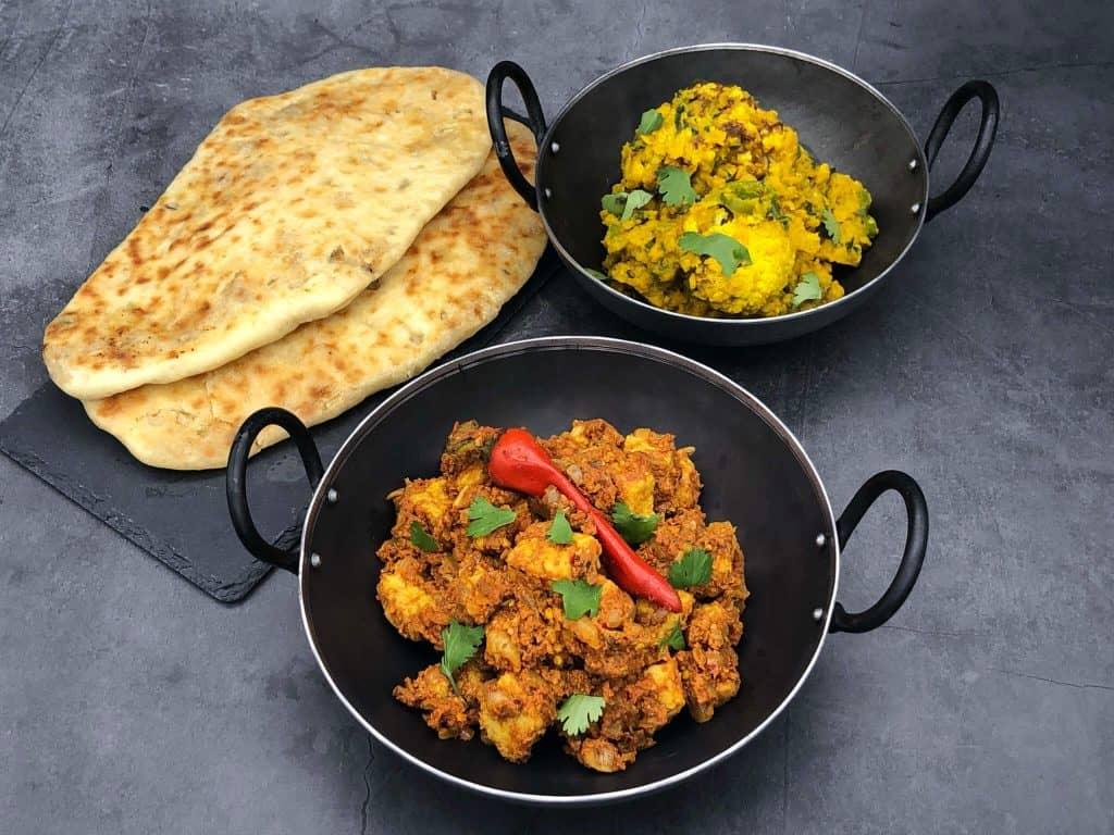 Indian side dishes and naan bread
