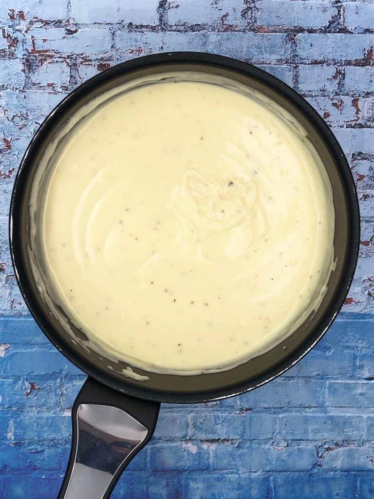 A saucepan of homemade cheese sauce