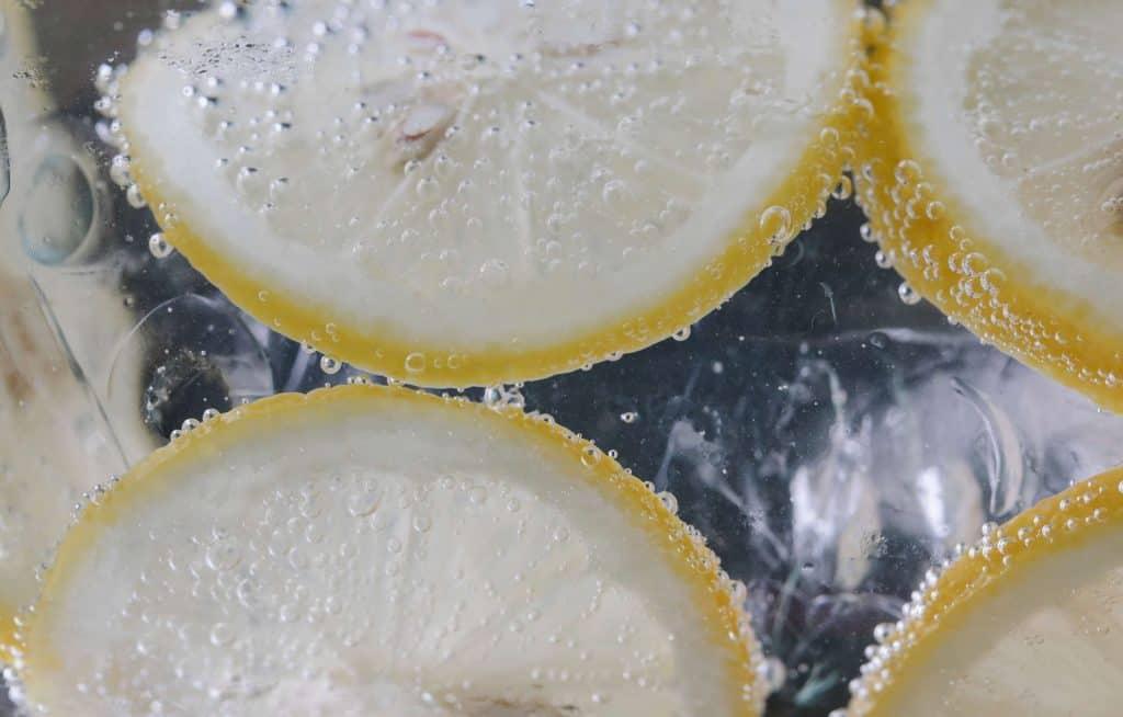 Lemon in sparkling soda water