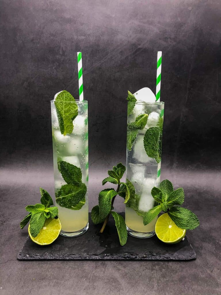 Two mojito cocktails, with lime and mint