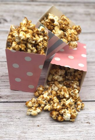 Three boxes of tasty salted caramel popcorn ready to eat