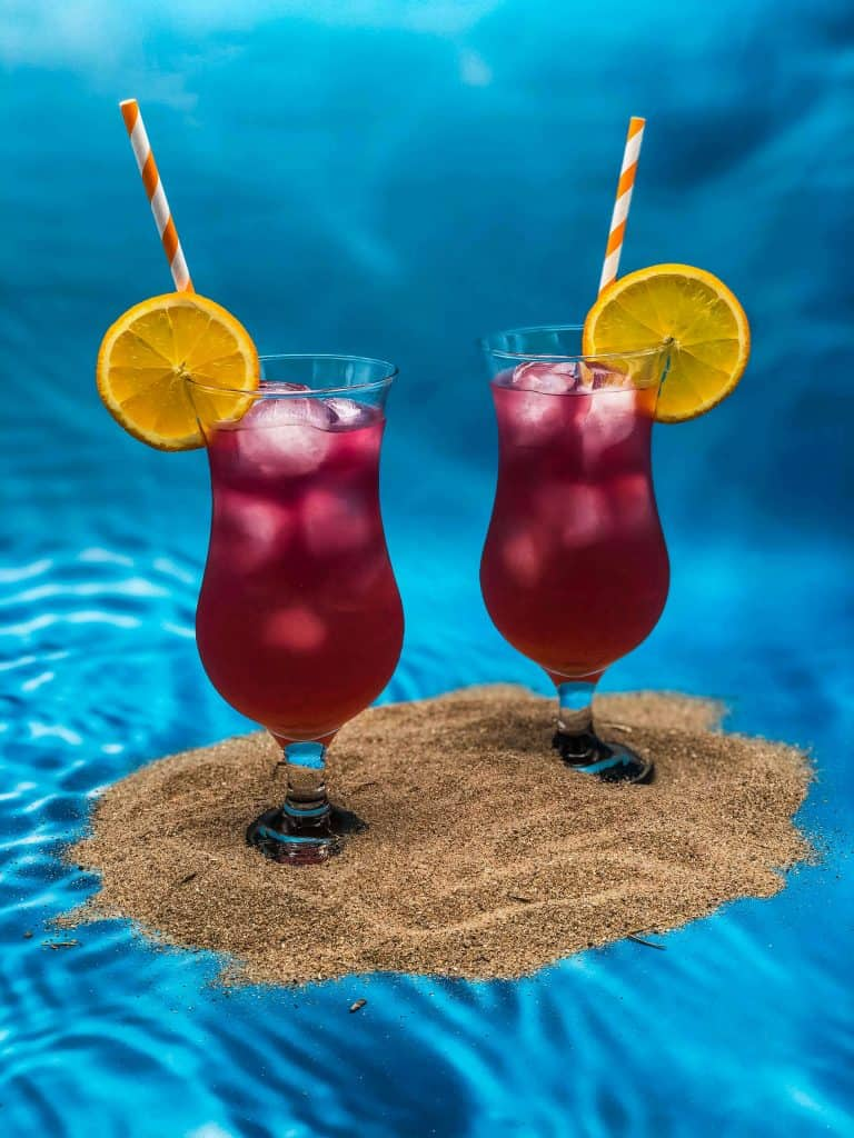Sex on the Beach cocktails with straws and orange slices