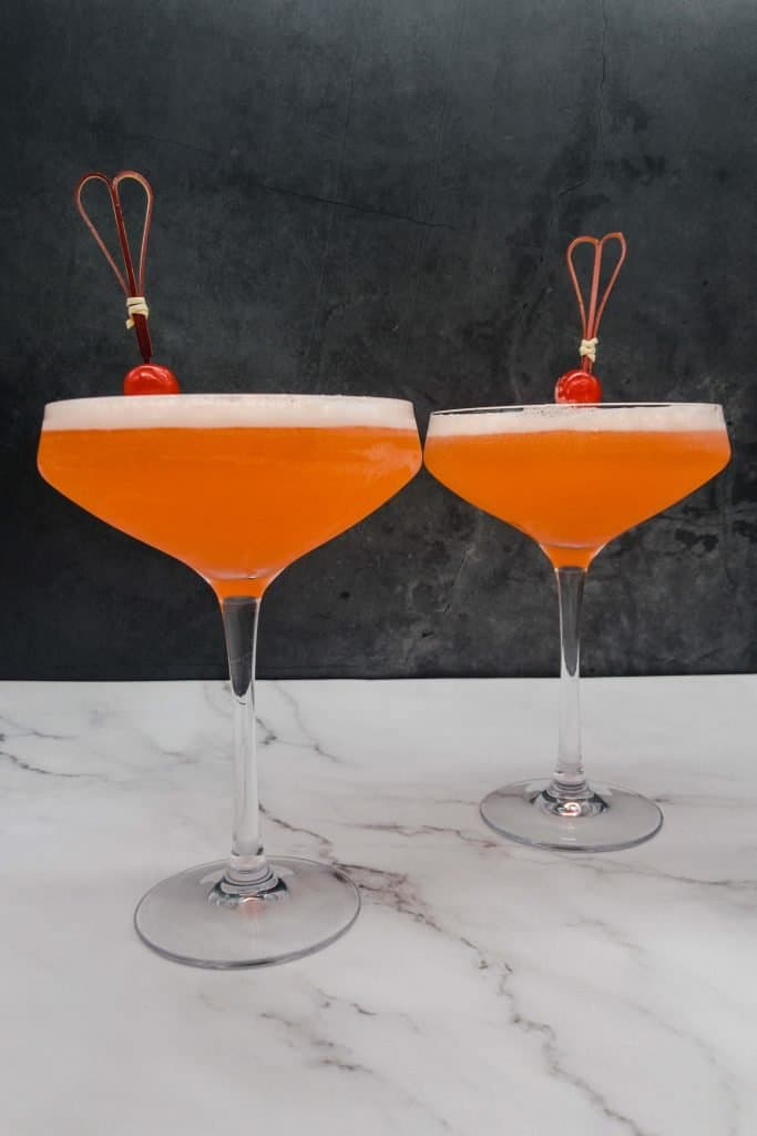 Two aperol sour cocktails ready to drink