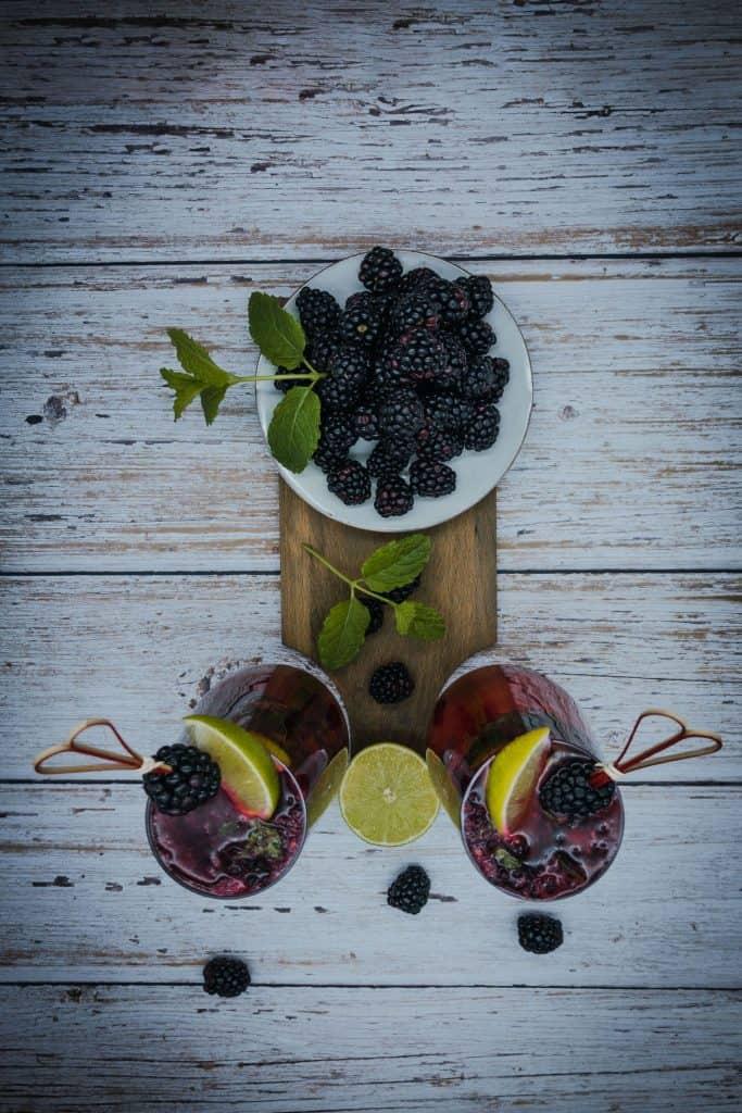 Overhead shot of blackberry mojito and blackberries
