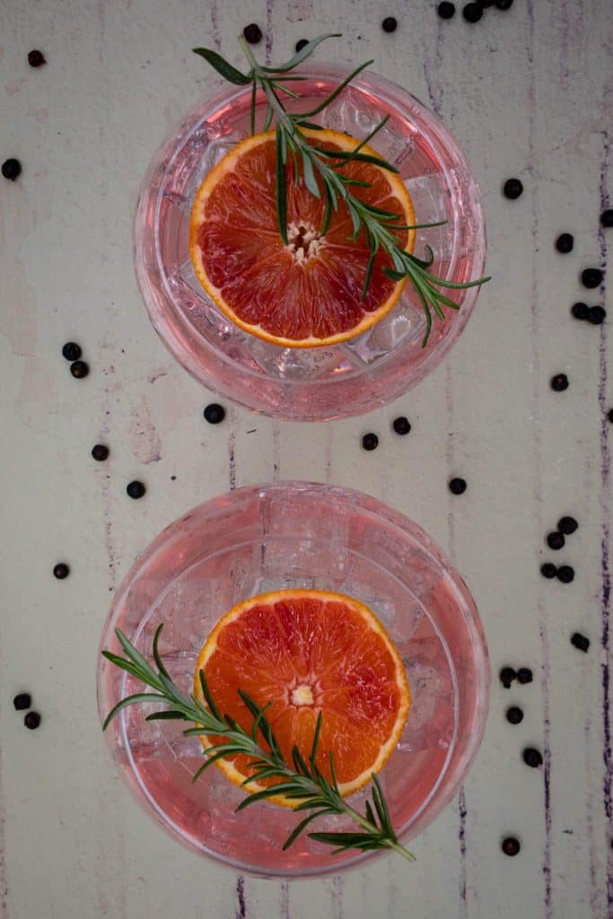 Two glasses of blood orange gin and tonics