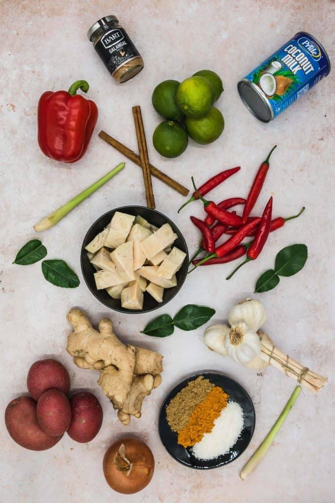 Ingredients for jackfruit rendang curry including lemon grass, coconut milk, young jackfruit and garlic cloves