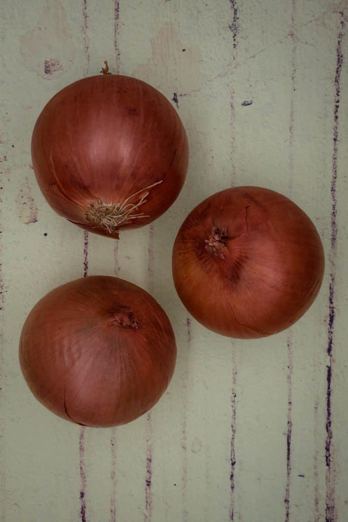 Three brown onions