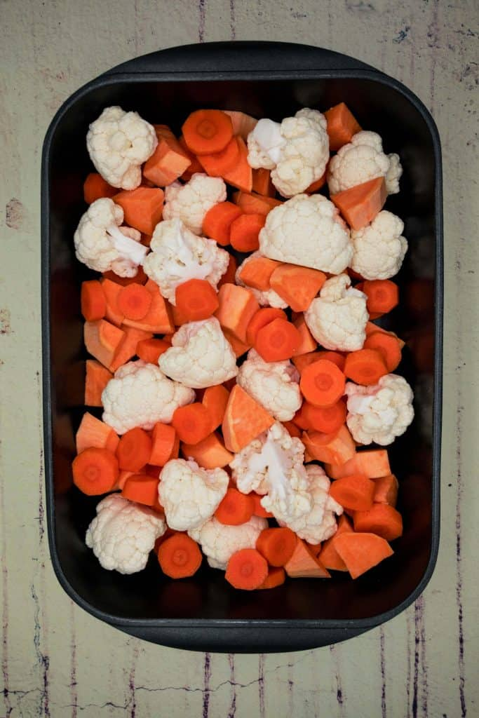 Vegetables in a roasting tin ready for the oven
