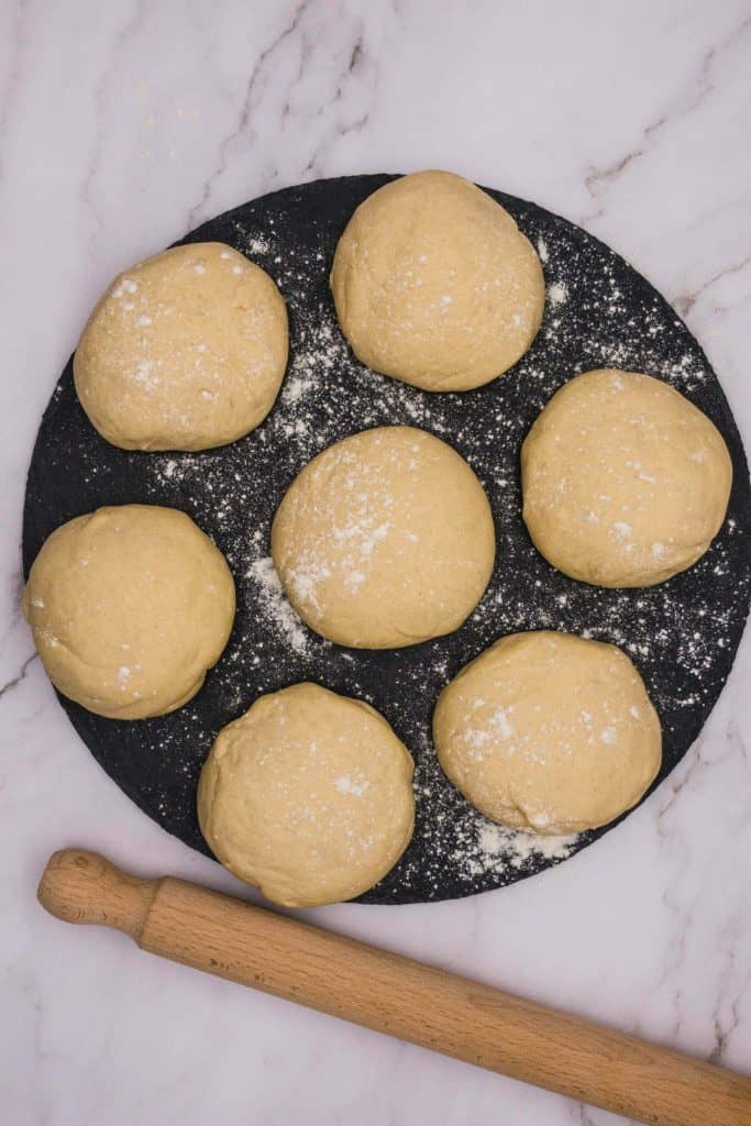 Soft Indian naan dough balls ready to roll before being cooked