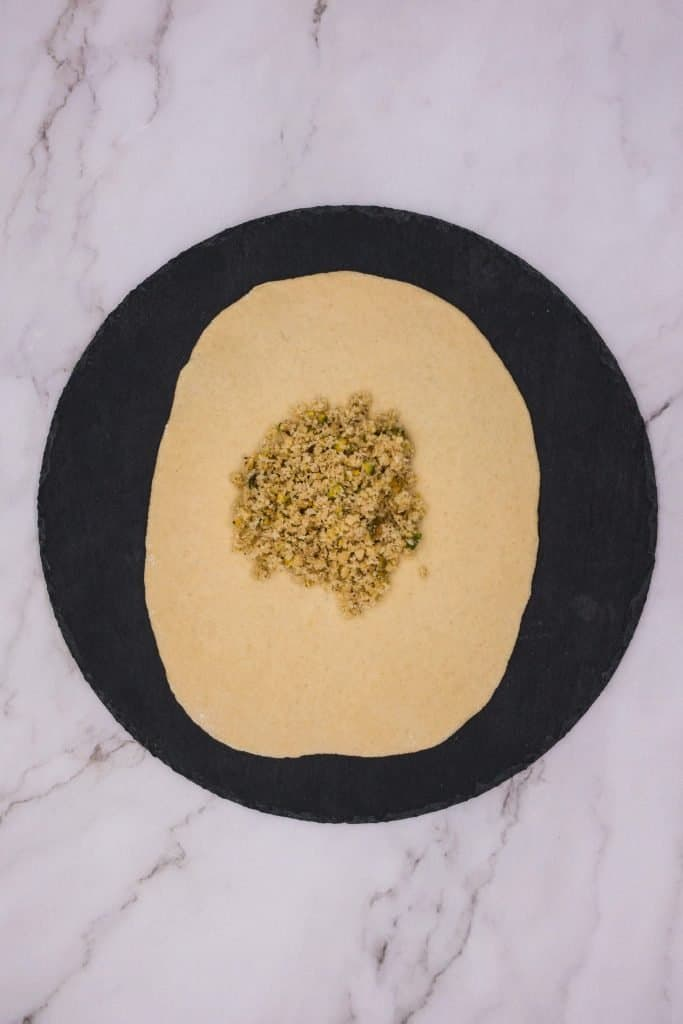 Peshwari naan with sweet coconut and nut filling ready to roll