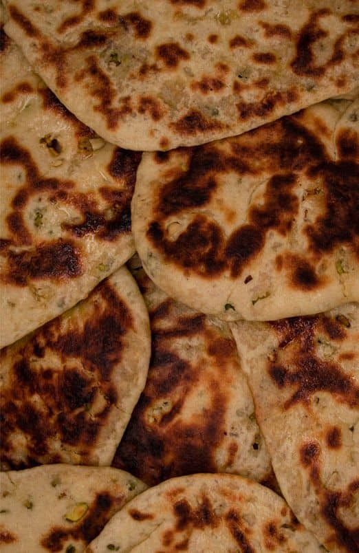 Peshwari naans stuffed with desiccated coconut, sugar and almonds