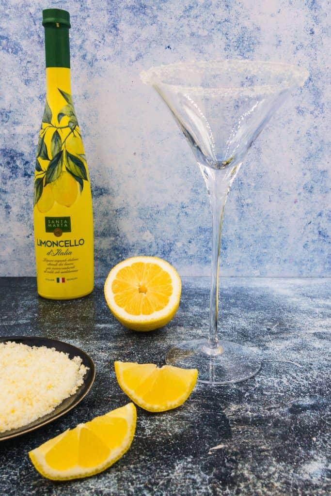 Limoncello bottle with a martini glass with a sugar rim