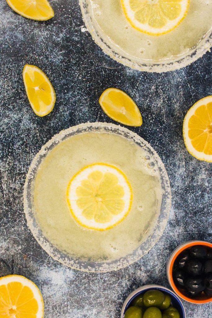 Slice of fresh lemon floating in limoncello martini