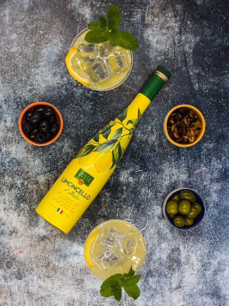 Ingredients for limoncello spritz including mint and ice