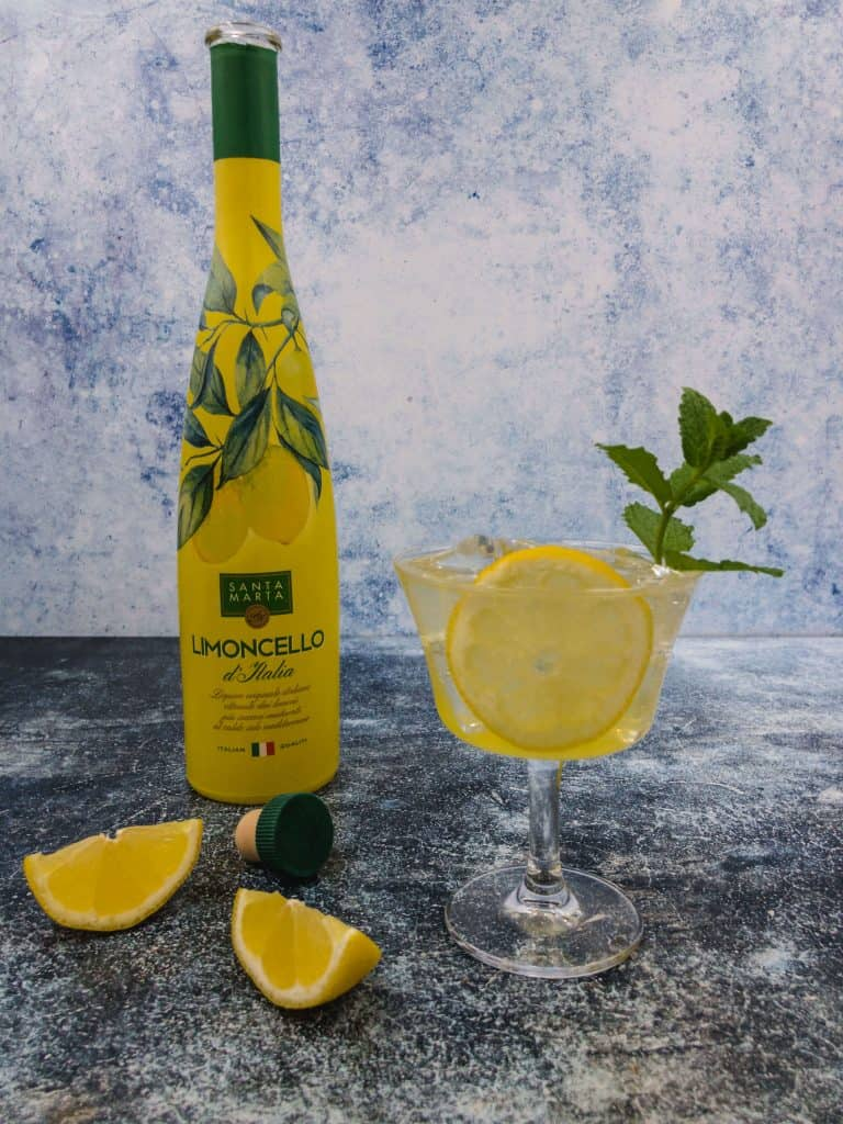 Limoncello spritz cocktails with a sprig of mint and wedge of lemon
