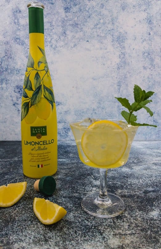 Limoncello spritz cocktail ready to drink with mint, ice and slice of lemon