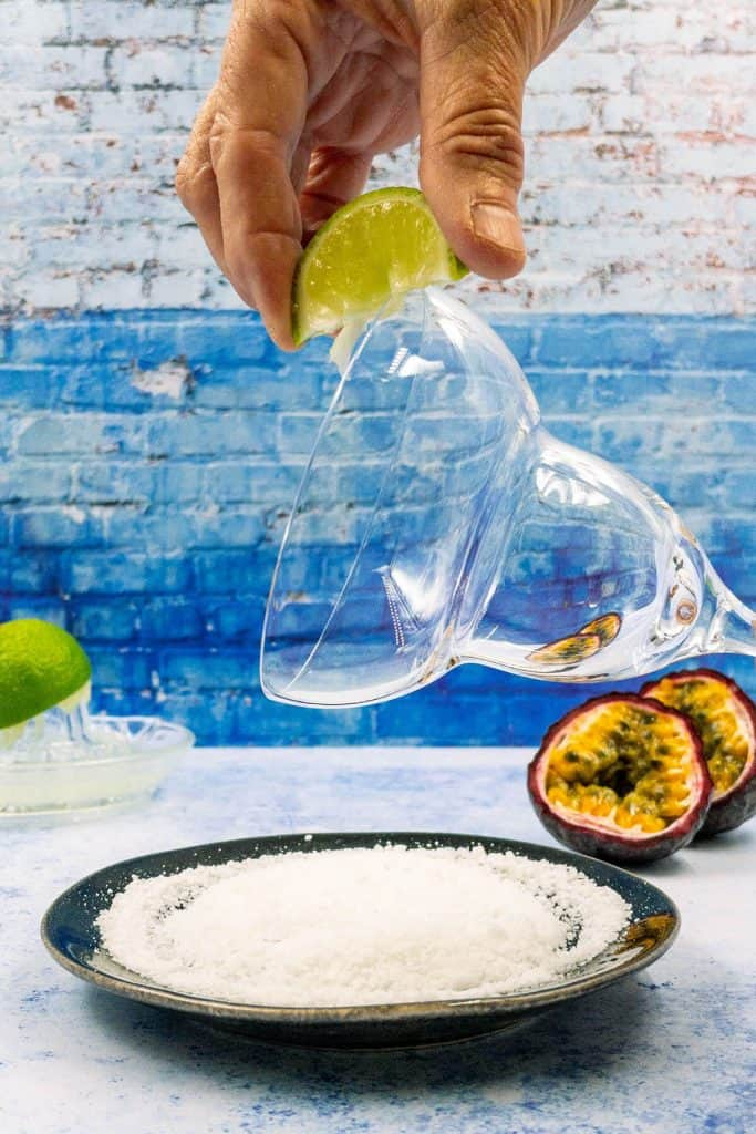 Wiping margarita glass with lime wedge