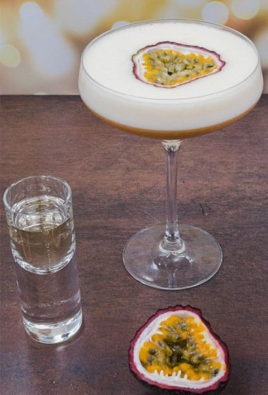 Pornstar martini cocktail freshly made with a shot of prosecco and passion fruits