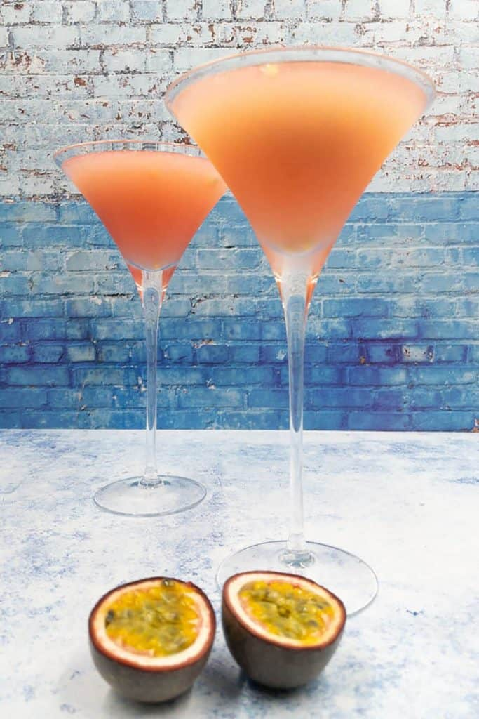 Two passion fruit daiquiris in cocktail glasses made with passionfruit liqueur
