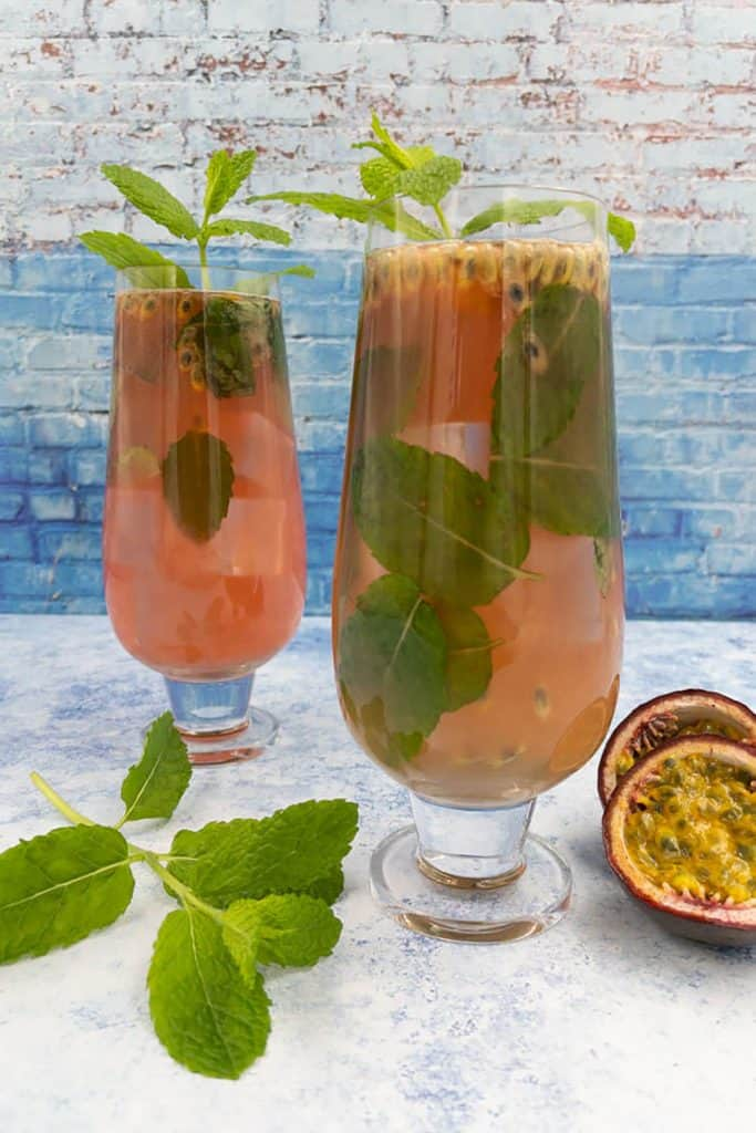 Two passion fruit mojitos in glasses