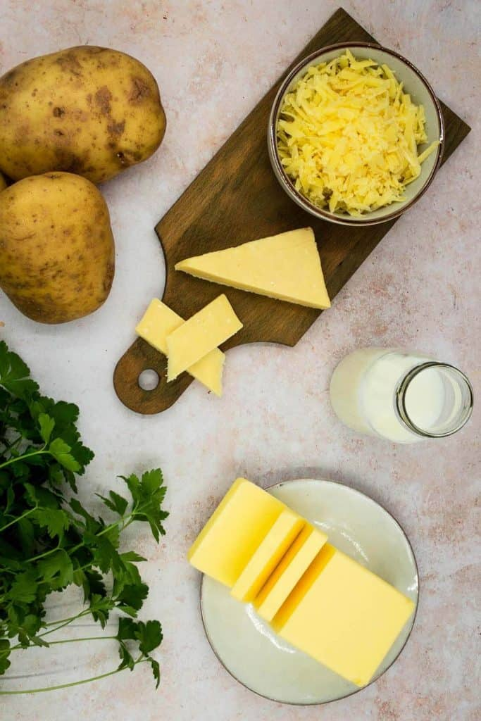 Grated cheese, butter, potatoes and parsley