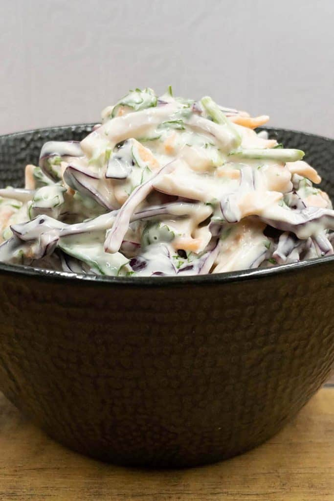 A bowl of homemade fresh crunchy red cabbage slaw