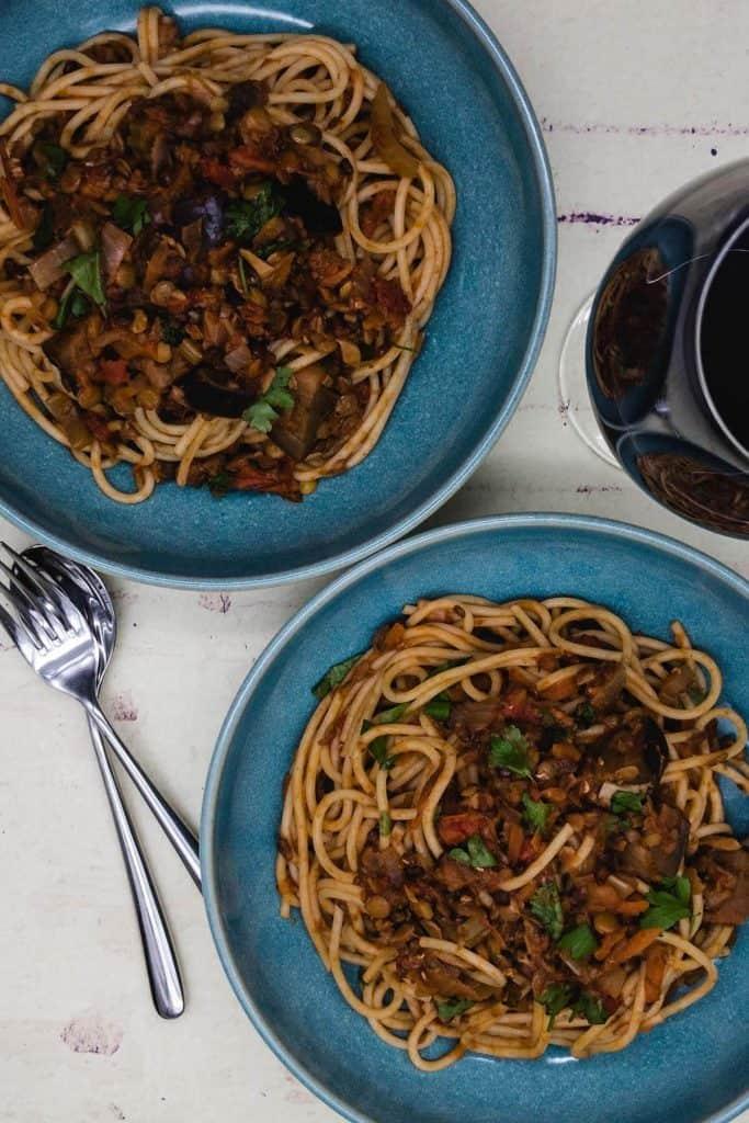 Two bowls of vegan spaghetti bolognese