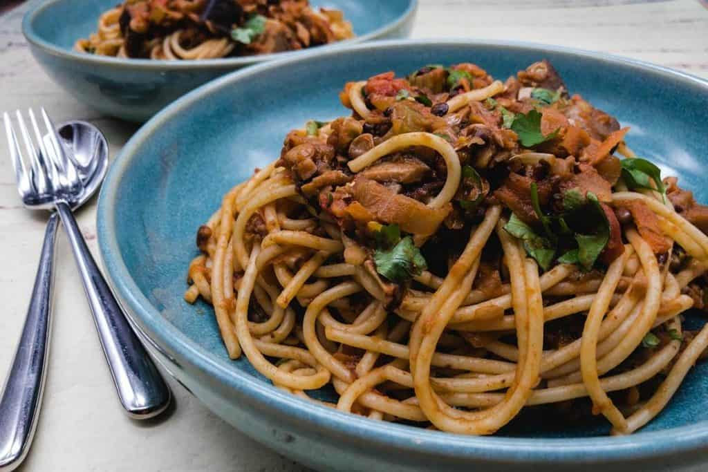 Vegetarian bolognese and a glass of red wine