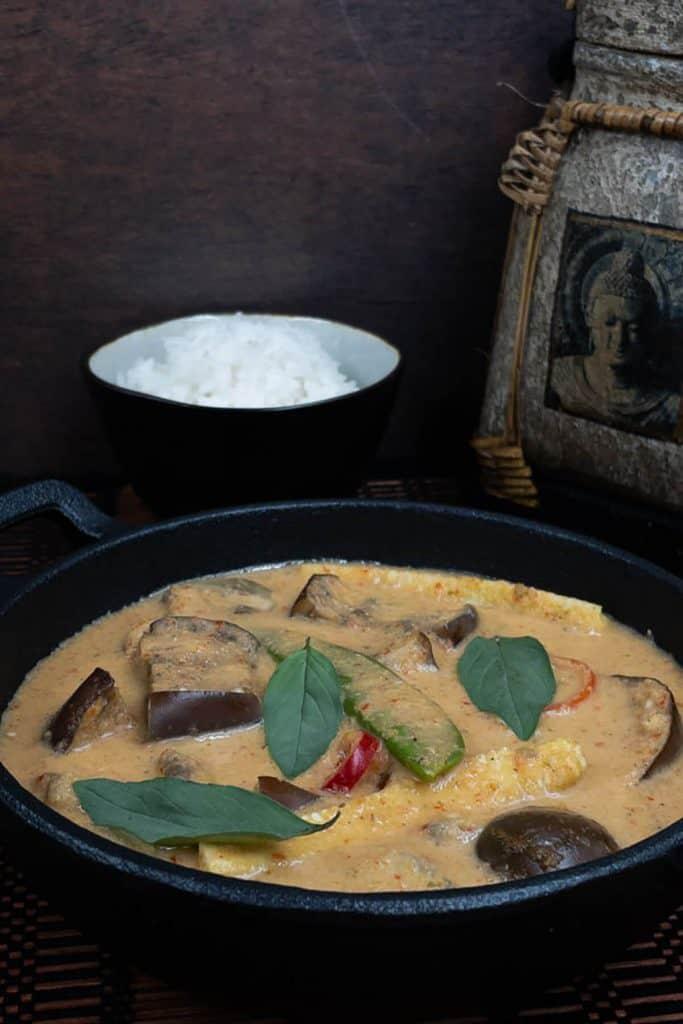 Vegan Thai red curry, jasmine rice, garnished with Thai basil