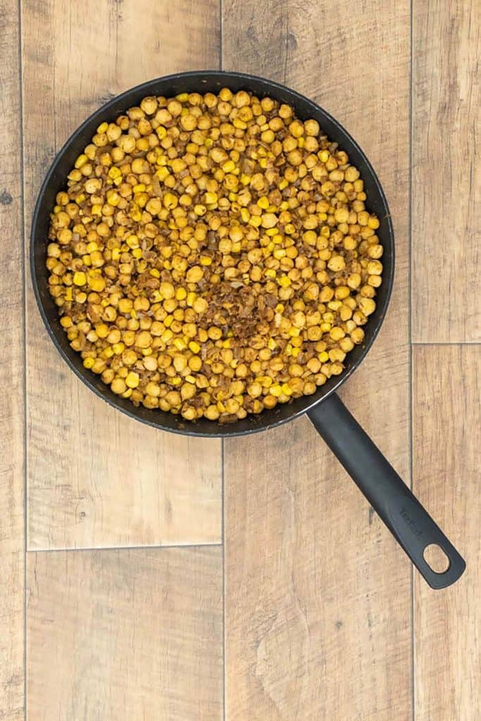 Chickpeas cooking in onion, garlic and ginger, following chickpea burger recipe