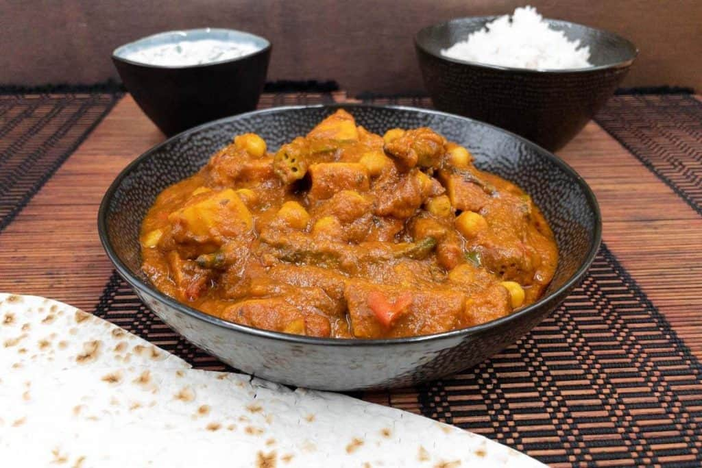 Tasty vegetarian vindaloo with vegetables, mint raita, basmati rice and chapati.