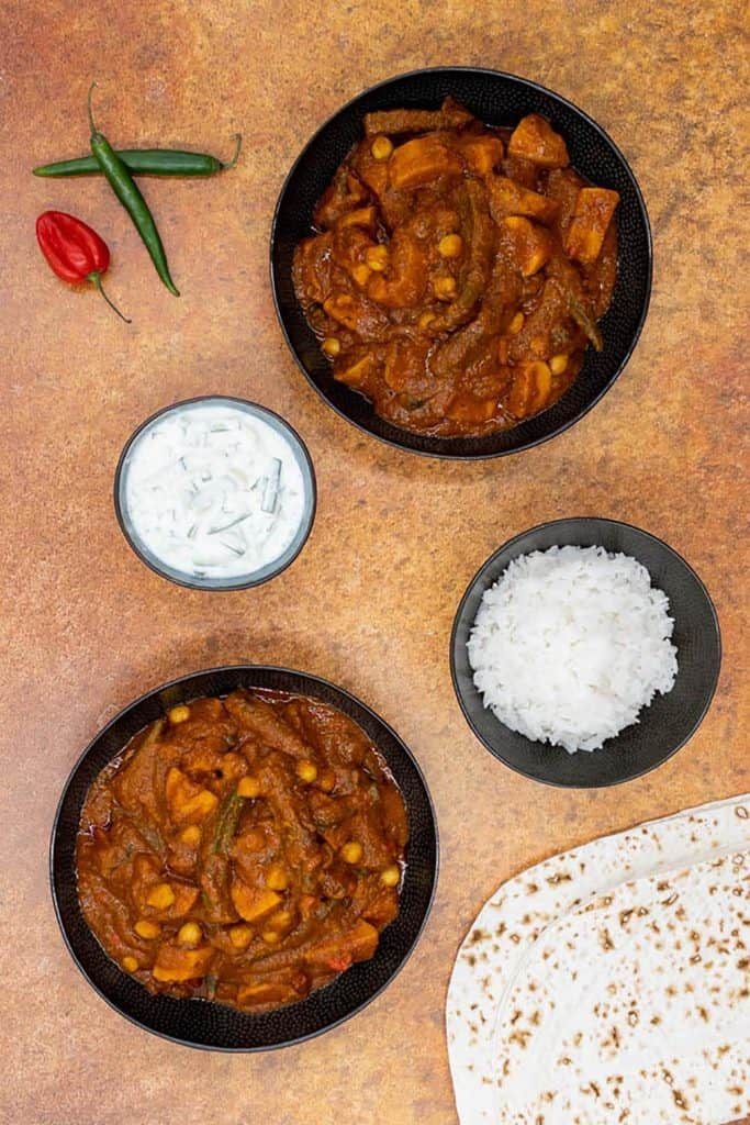 Vegetarian vindaloo, full of spices, with chilli's, mint raita, basmati rice and chapati