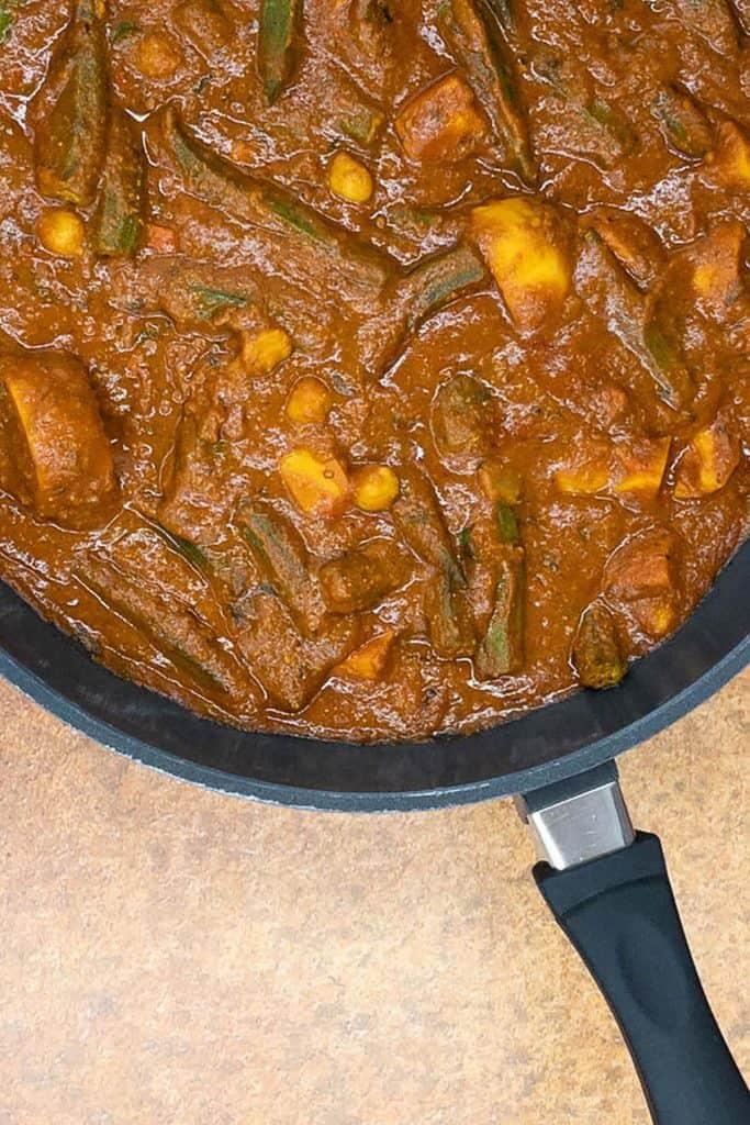 A pan of freshly made vegetarian vindaloo with chickpeas, sweet potatoes and okra