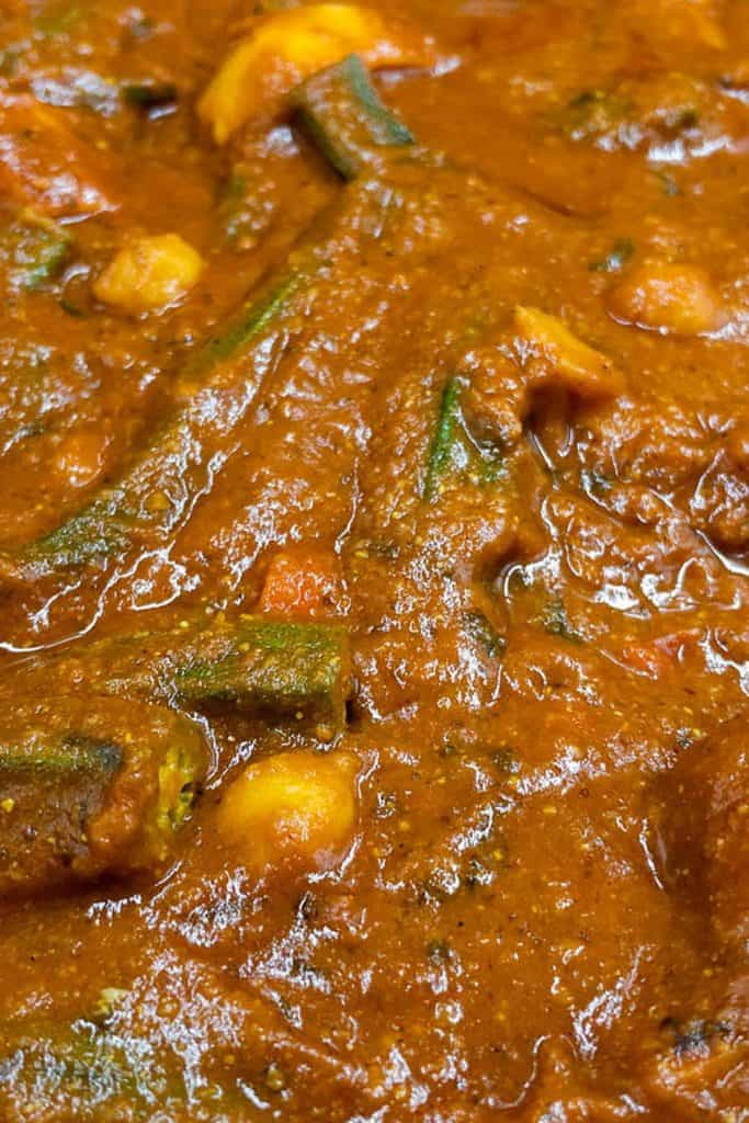 Close up of vegetarian vindaloo with chickpeas, okra and sweet potatoes.