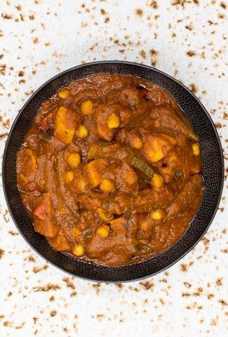 A dish of vegetarian vindaloo on a giant chapati.