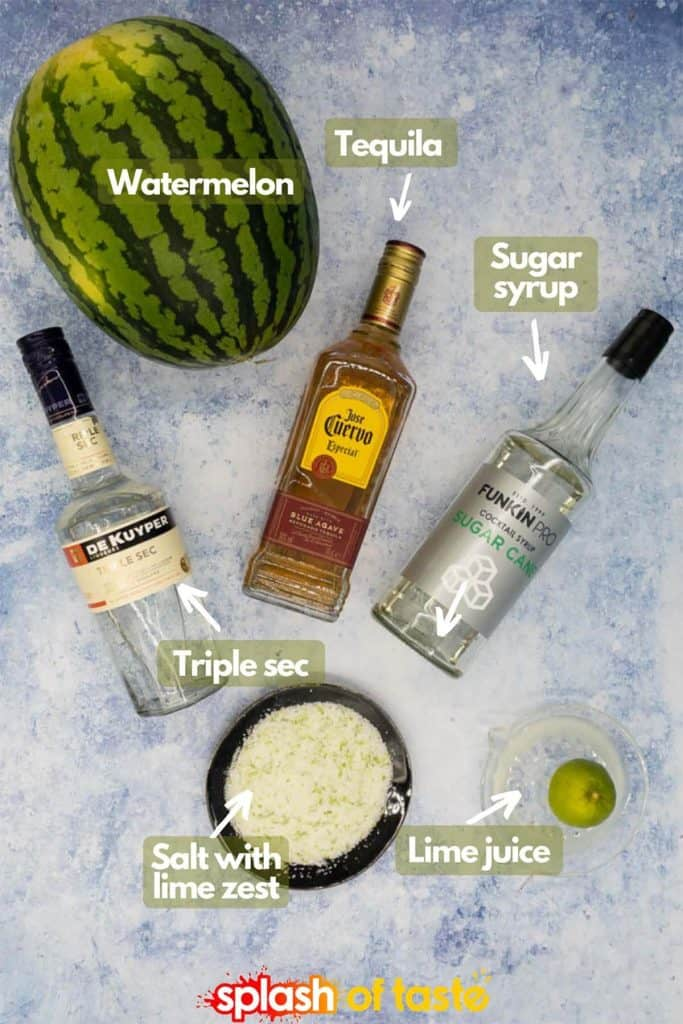 Ingredients to make watermelon margaritas, tequila, triple sec, sugar syrup, watermelon, lime juice and salt with lime zest