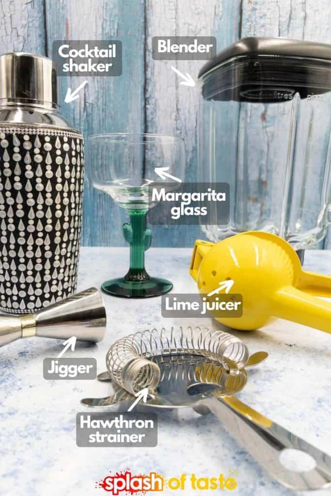 Equipment to make watermelon margarita cocktail shaker, blender, margarita glass, lime juicer, jigger and Hawthorne strainer